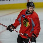 Spencer Abbott wearing a Chicago Blackhawks jersey on the ice.