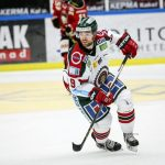 Spencer Abbott skating down the ice in his Frolunda Indians jersey.