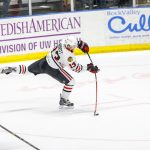 Spencer Abbott making a quick shot attempt in his Chicago Blackhawk jersey.