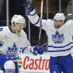 Spencer Abbott celebrating on the ice with a teammate as a Toronto Marlies.