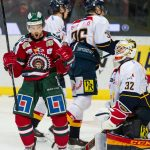 Spencer Abbott celebrating in his Frolunda Indians jersey.